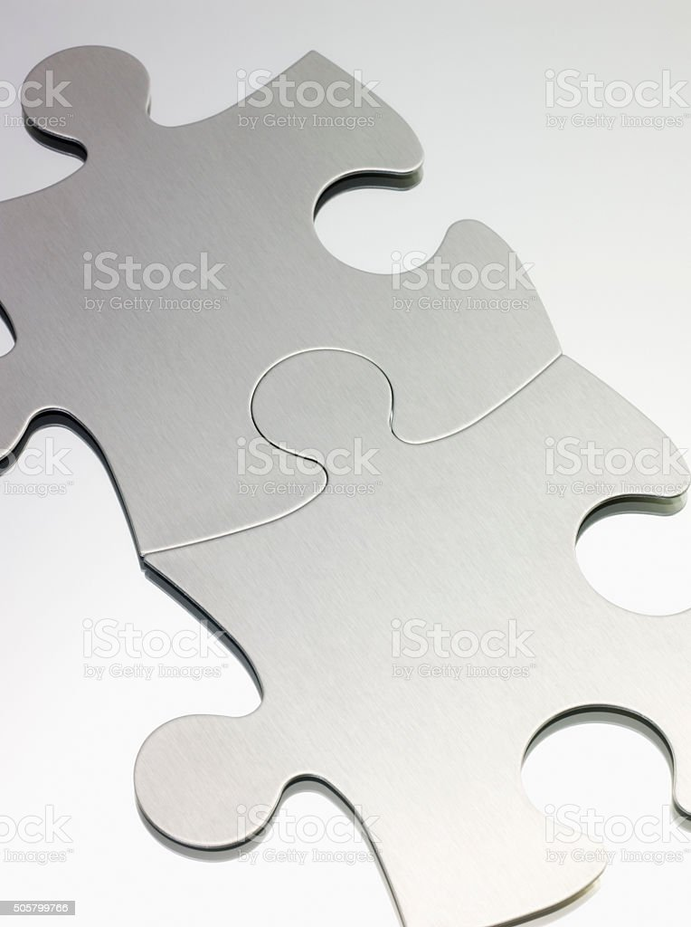 Two blank jigsaw puzzle pieces, close up stock photo