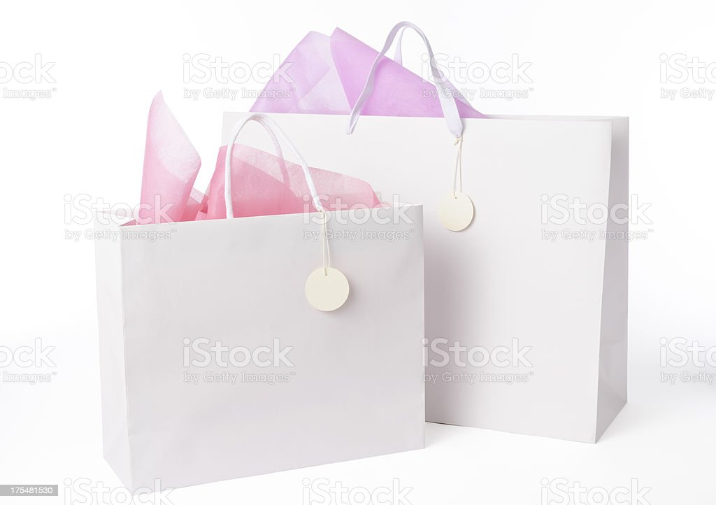 Two blank shopping bags with tag on white background stock photo