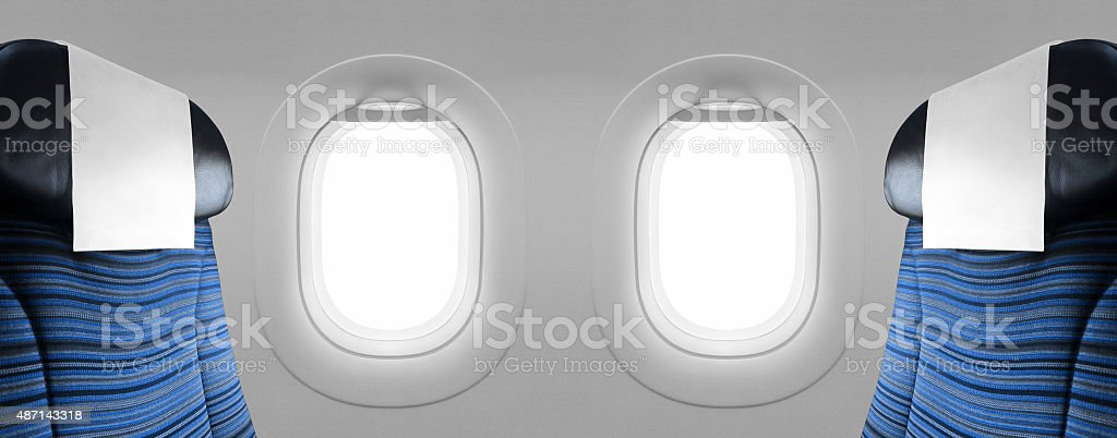 Two blank windows plane with blue seats stock photo
