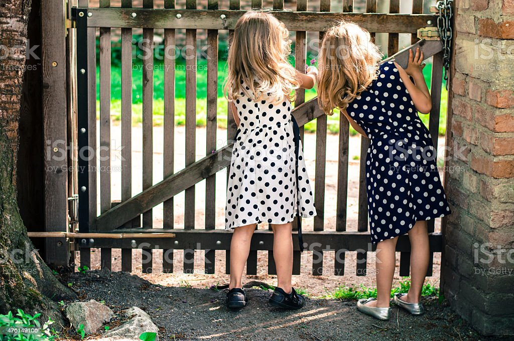 two blond curious girls stock photo