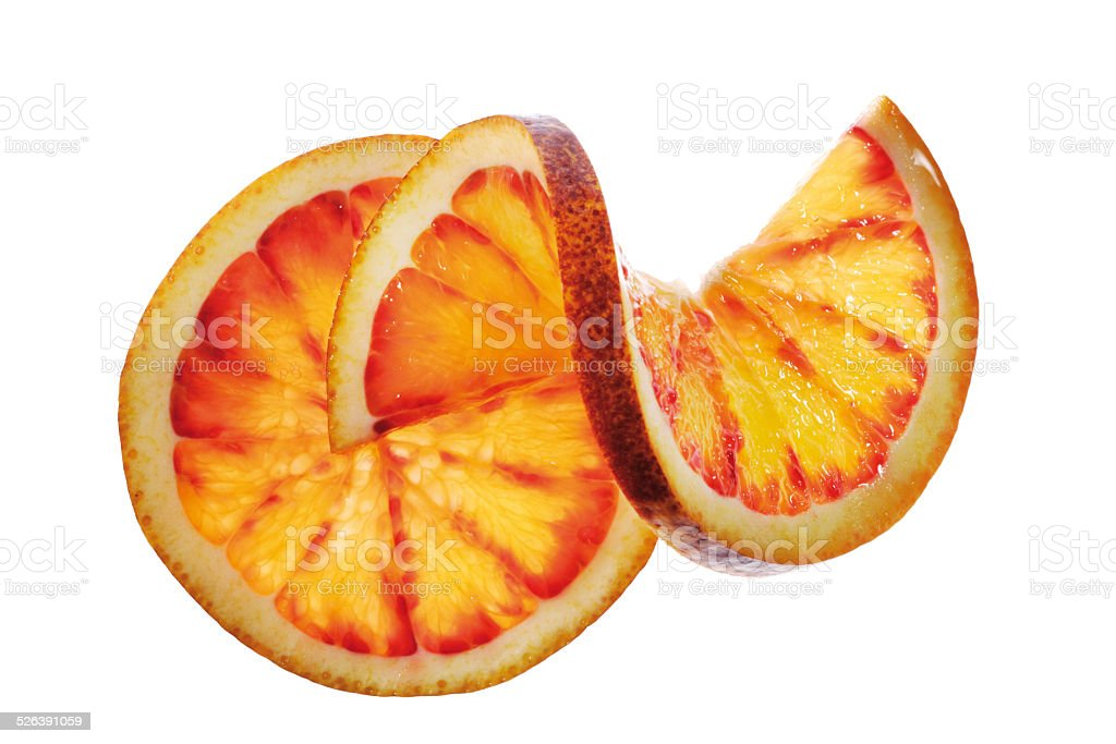Two blood orange slices, one chased, close-up stock photo