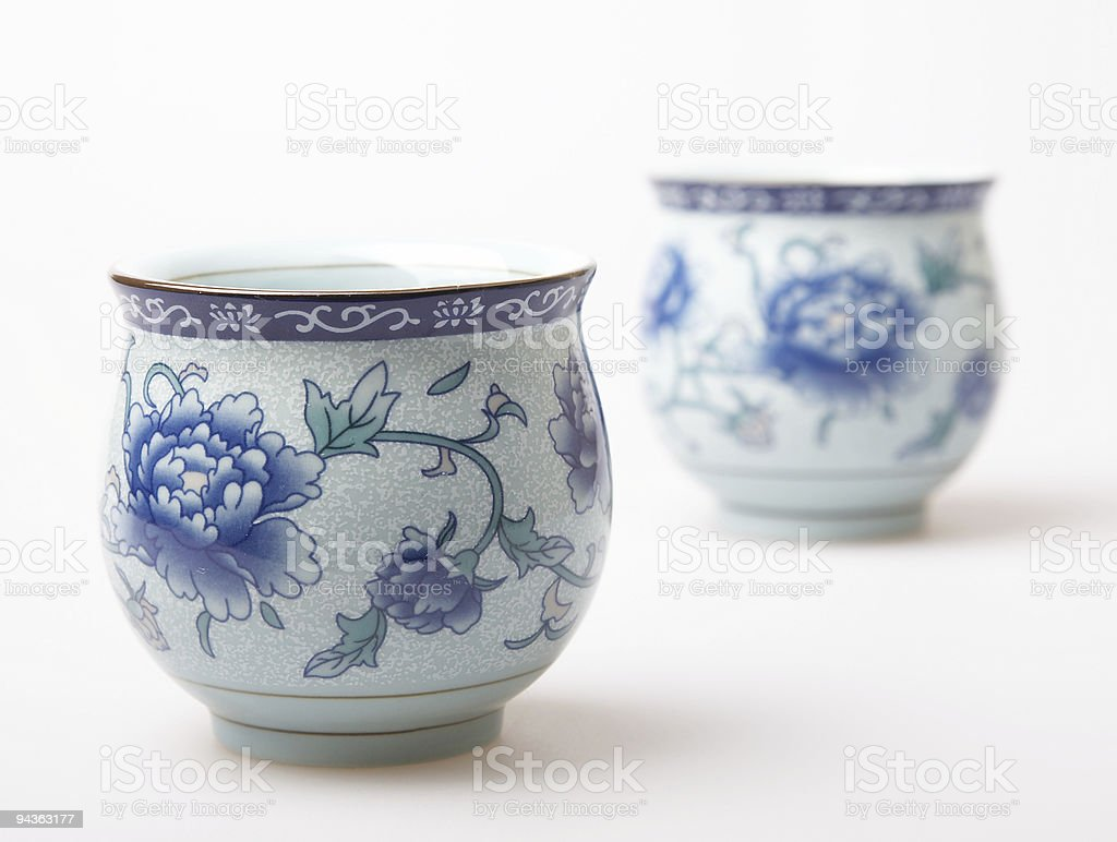 Two blue and white Chinese teacups stock photo