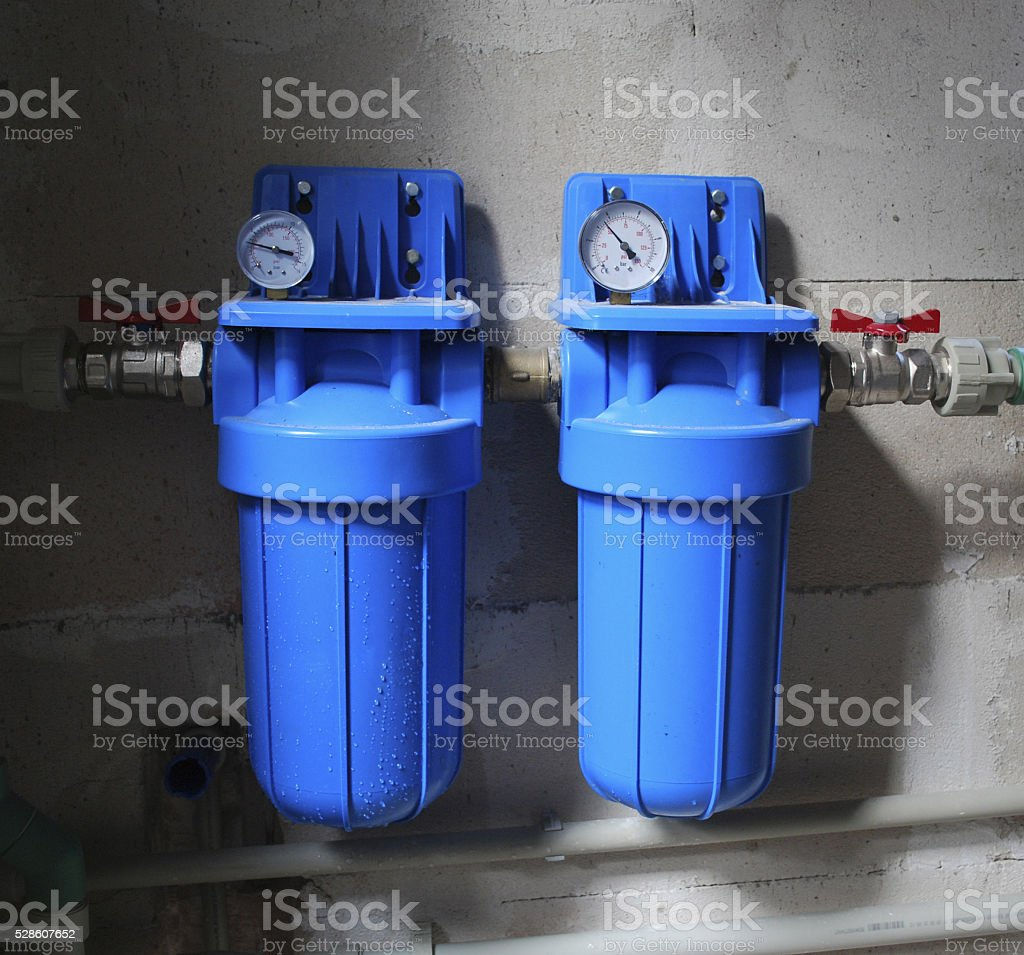 Two blue aqua filters with pressure meter. stock photo