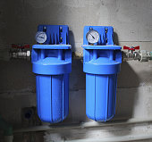 Two blue aqua filters with pressure meter.