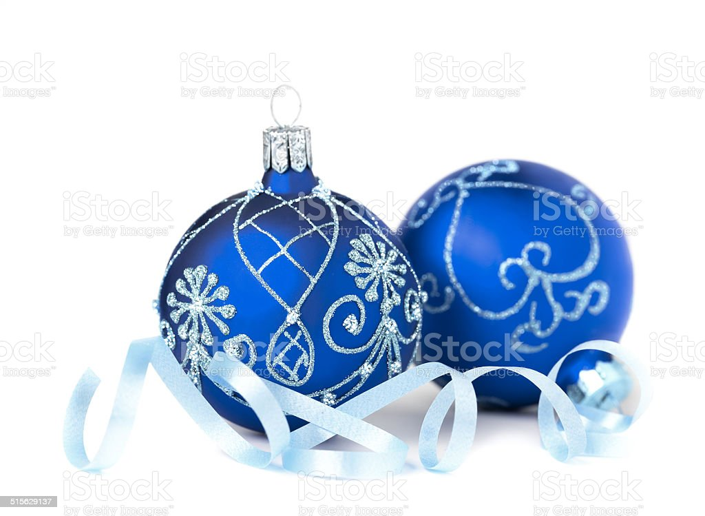 Two blue Christmas Baubles on white stock photo