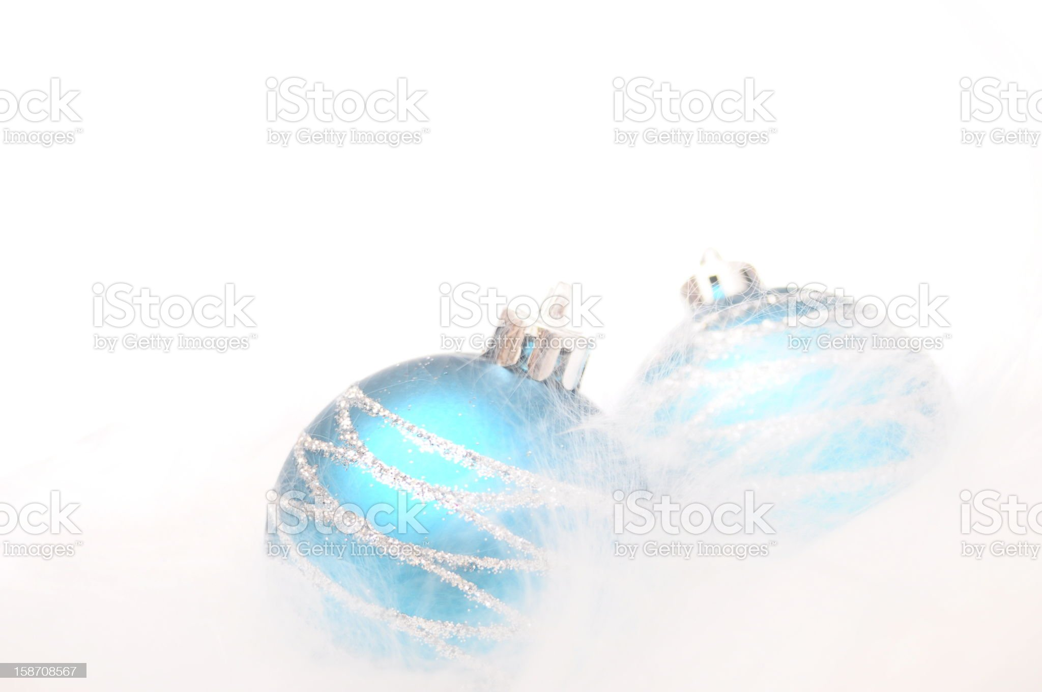 Two blue christmas baubles royalty-free stock photo
