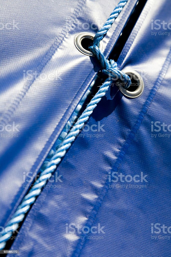 Two blue covers tied together royalty-free stock photo