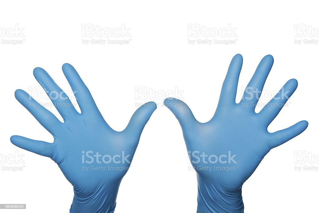 Two blue medical latex gloved hands palms out fingers spread stock photo