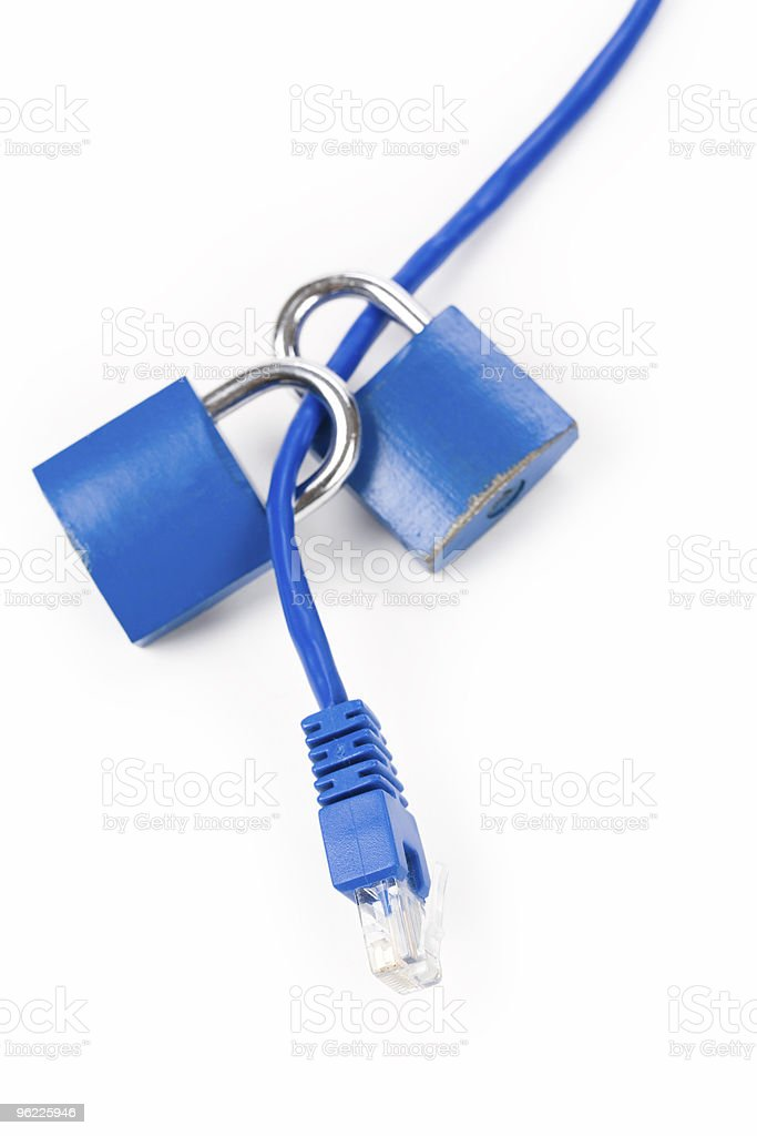 Two blue padlocks on a blue network cable royalty-free stock photo