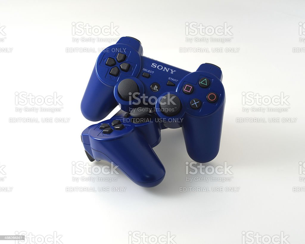 two blue ps3 controllers stock photo