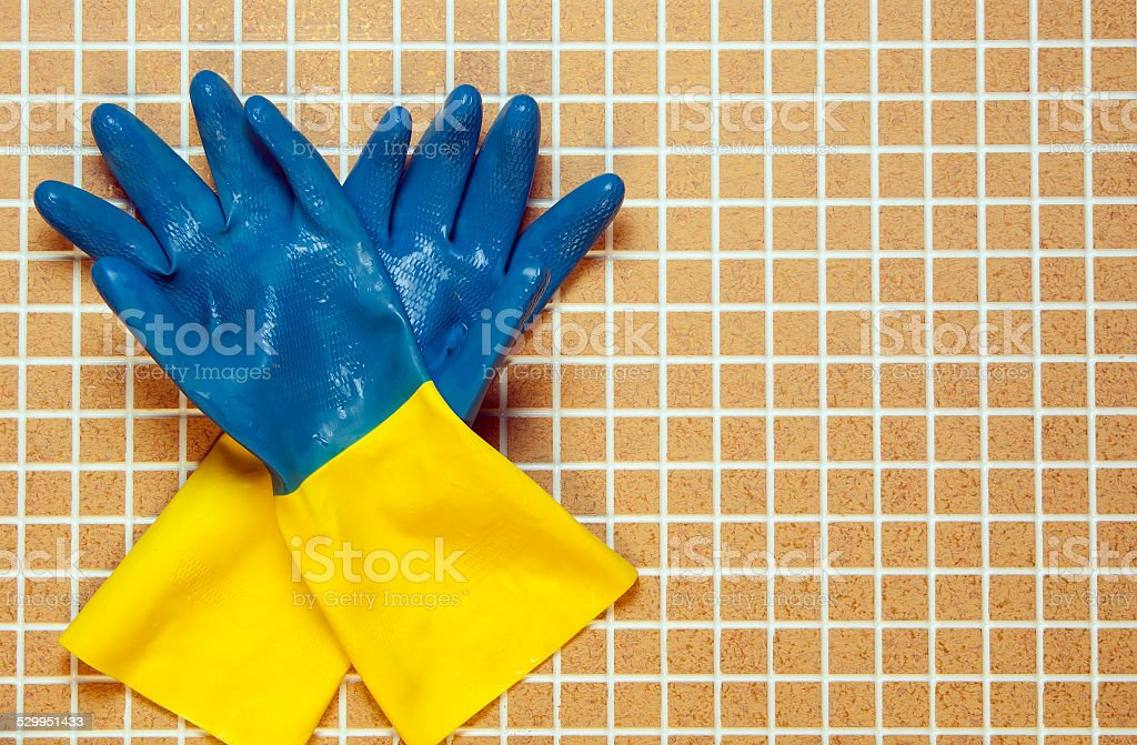 Two blue with yellow color rubber gloves royalty-free stock photo