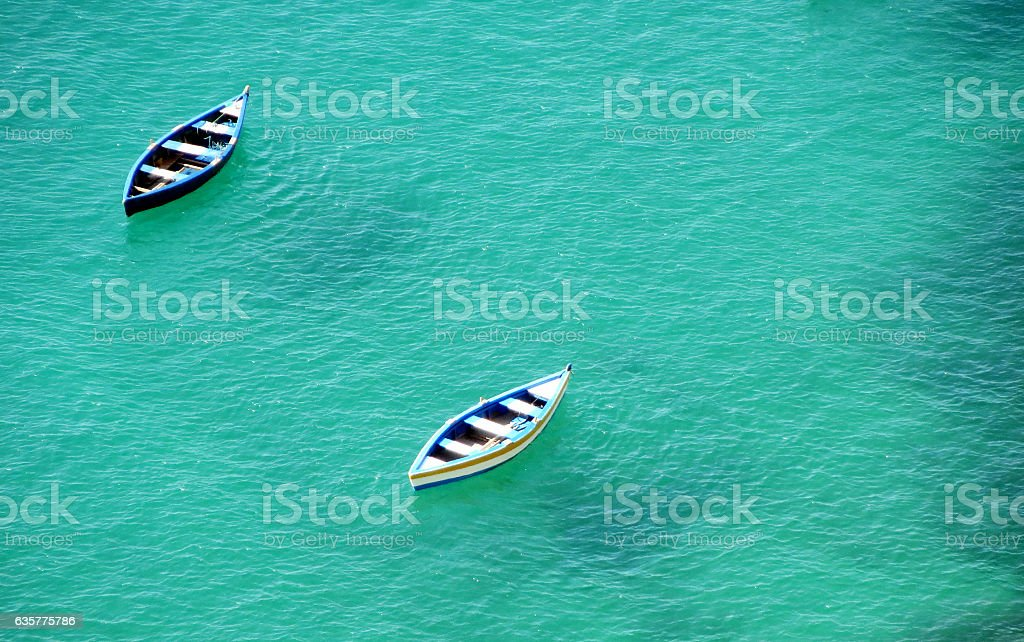 Two boats anchored at Bay of All Saints stock photo