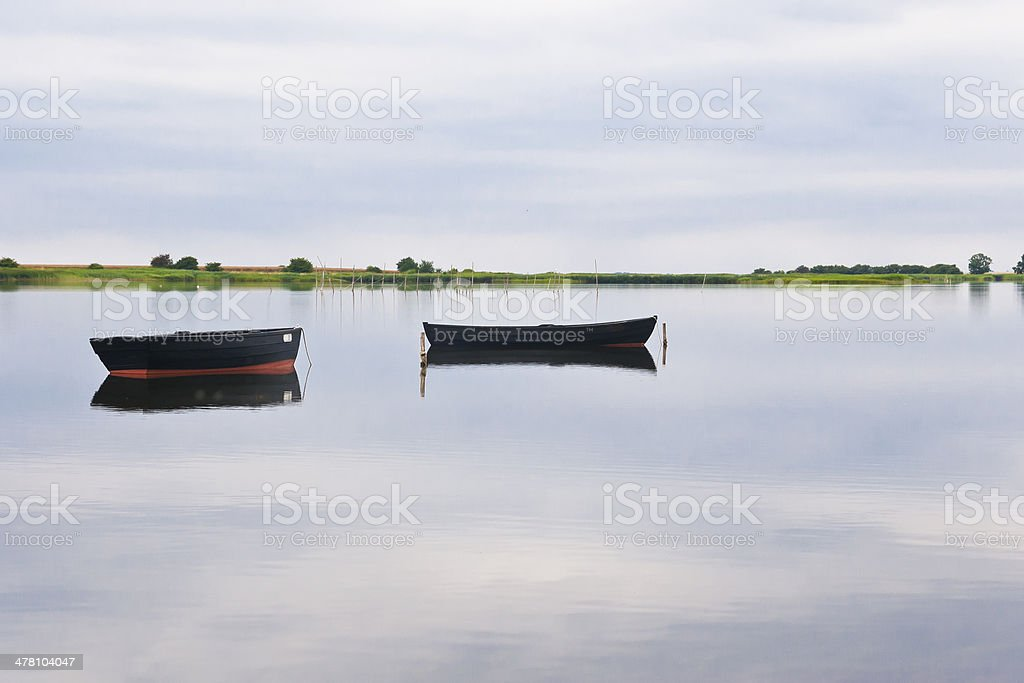 Two Boats and an Island royalty-free stock photo