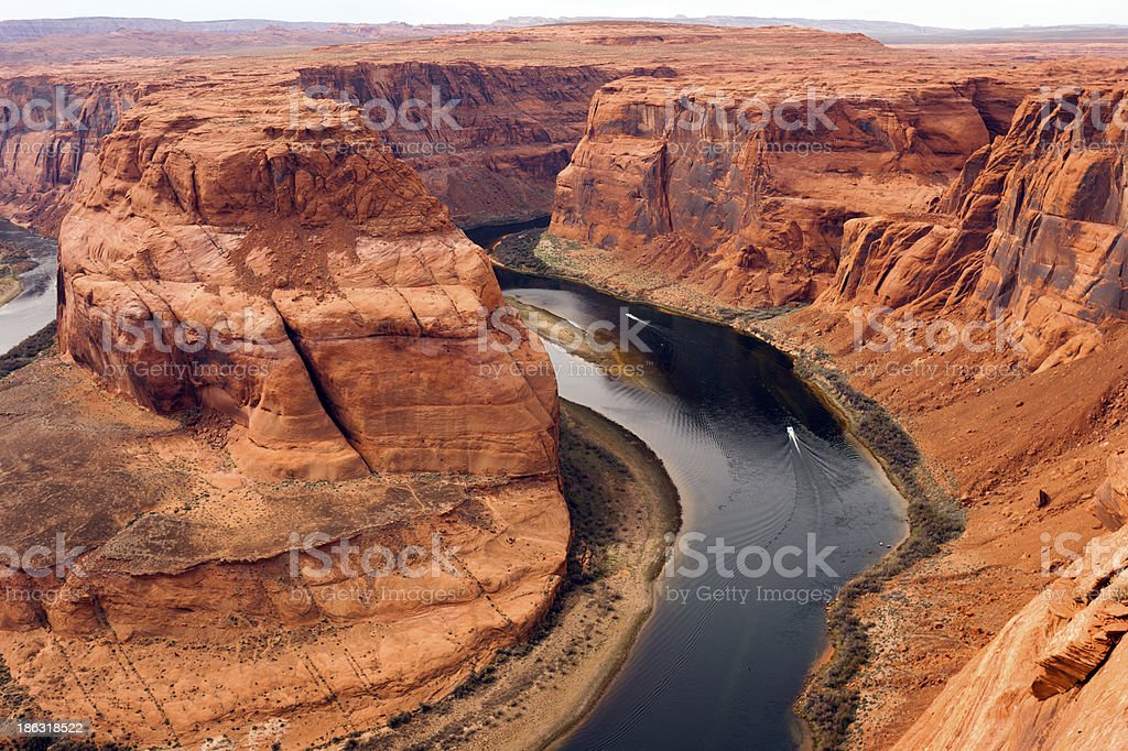 Two Boats Navigate Colorado River Deep Canyon Horseshoe Bend Southwest royalty-free stock photo