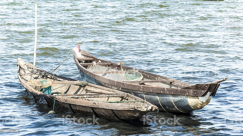 Two boats on the blue water royalty-free stock photo