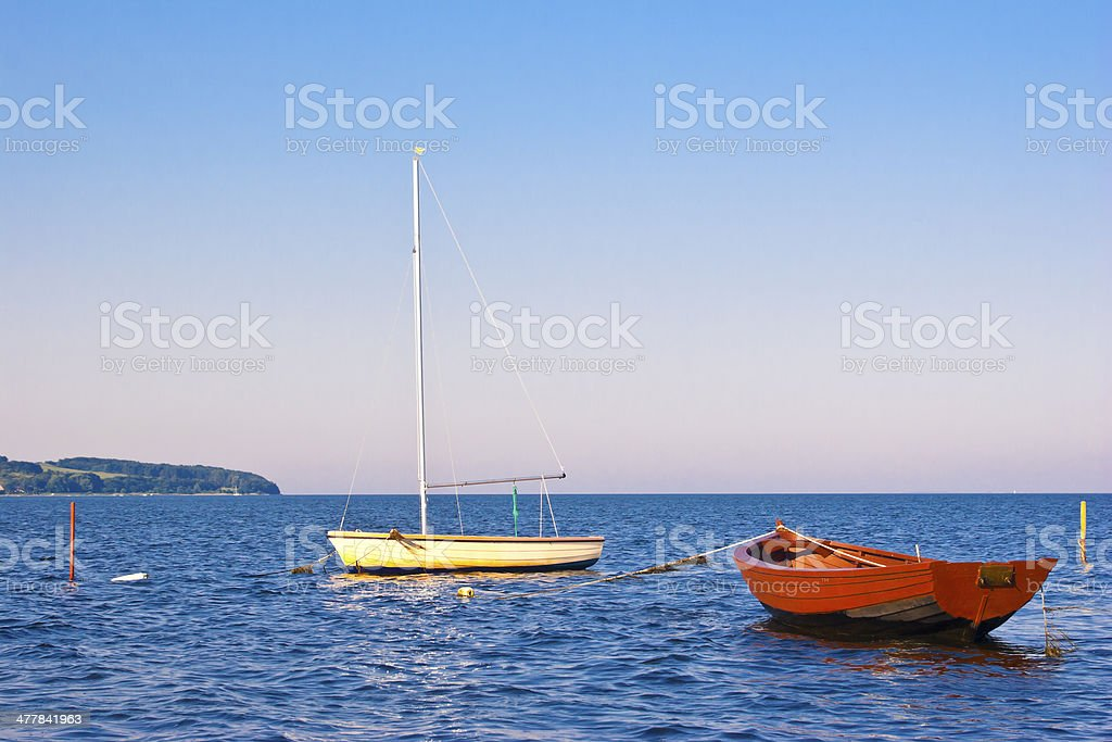 Two boats the sea and an island royalty-free stock photo
