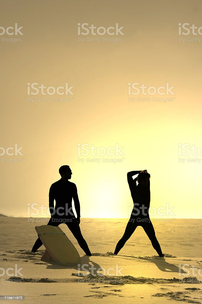 two bodyboarders at sunset royalty-free stock photo