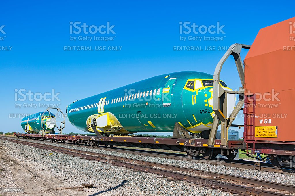 Two Boeing 737 aircraft fuselages on BNSF train stock photo