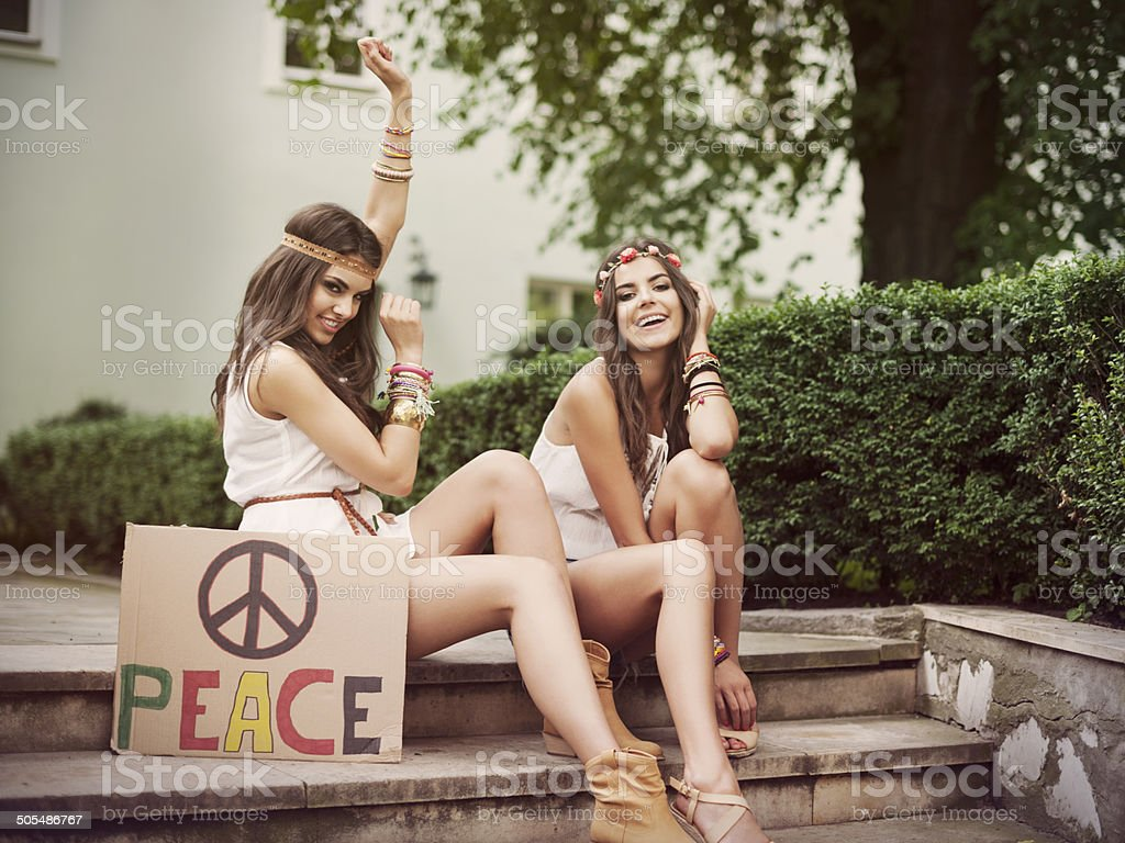 Two boho female friends in summer day royalty-free stock photo