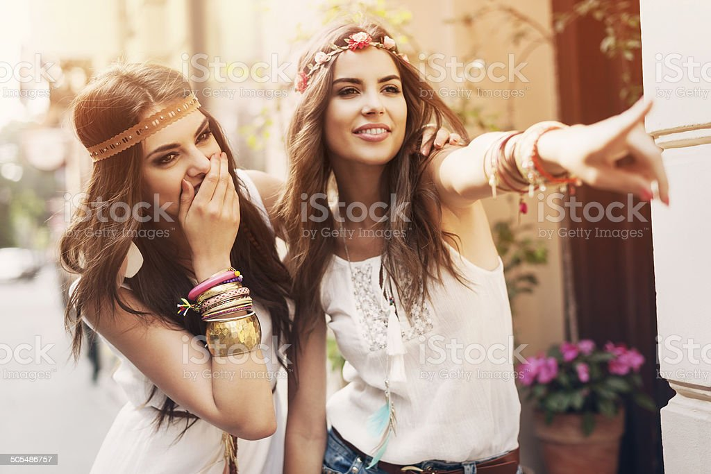 Two boho girls have fun in summer day stock photo