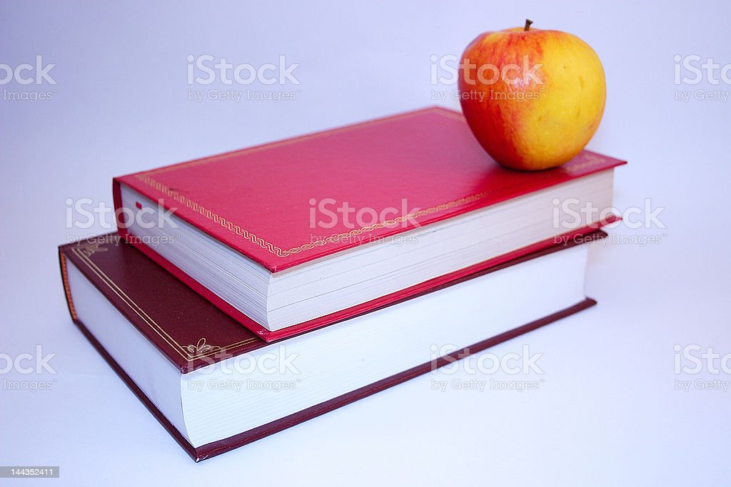 two books and a apple royalty-free stock photo