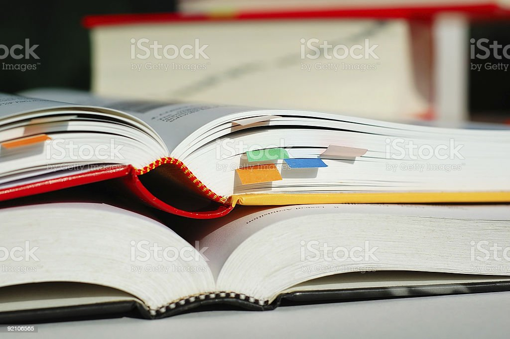 Two books opened and stacked stock photo