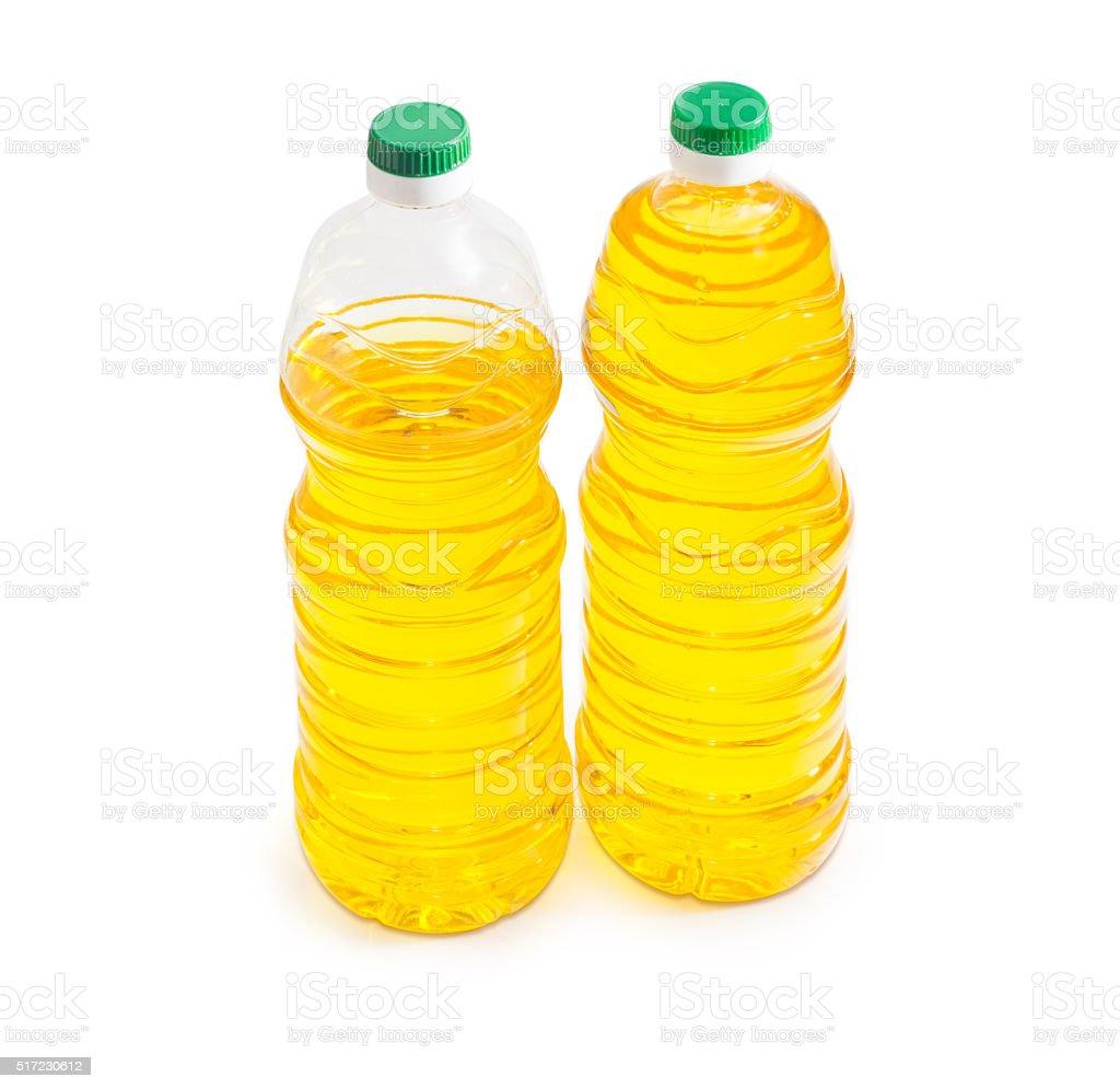 Two bottles of sunflower oil on a light background stock photo