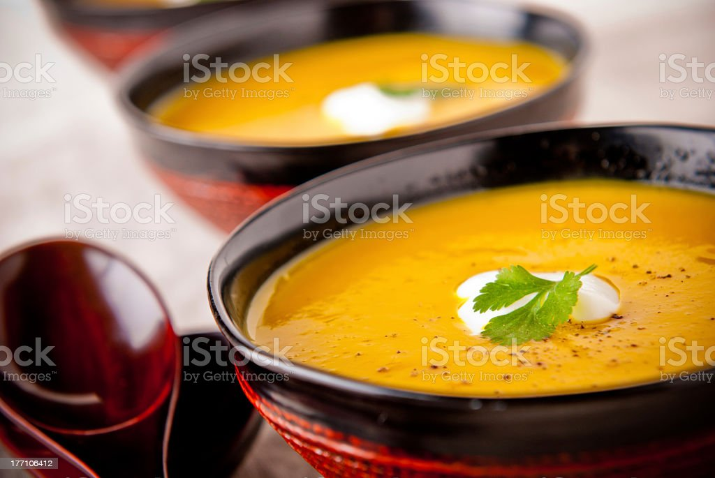 Two bowls of butternut squash soup stock photo