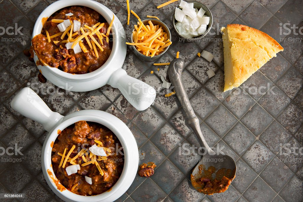 Two Bowls Of Chili And Corn Bread stock photo