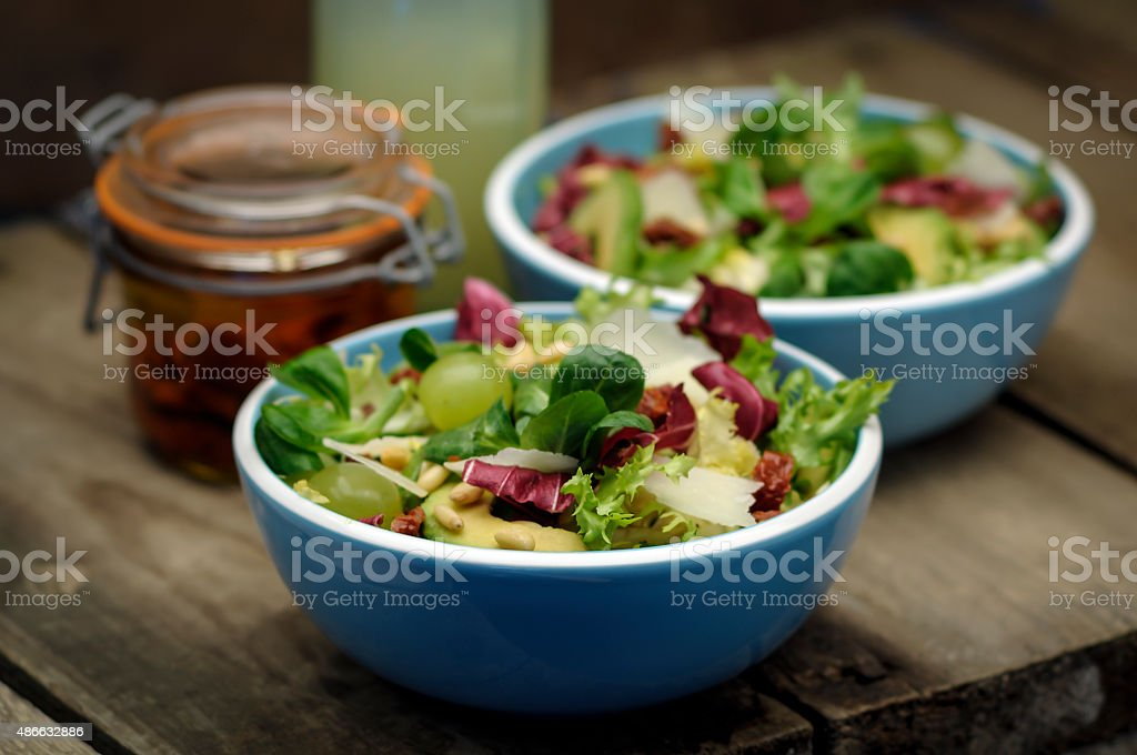 Two bowls of mixed leaf salad stock photo