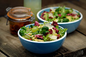 Two bowls of mixed leaf salad