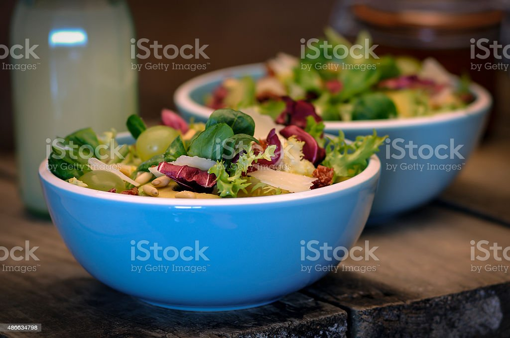Two bowls of mixed salad close up stock photo