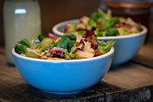 Two bowls of mixed salad close up