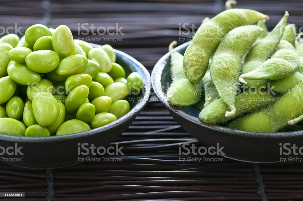 Two bowls one filled with soy beans royalty-free stock photo