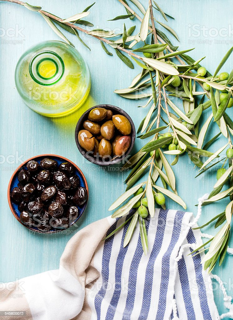 Two bowls with pickled green and black olives, olive tree stock photo