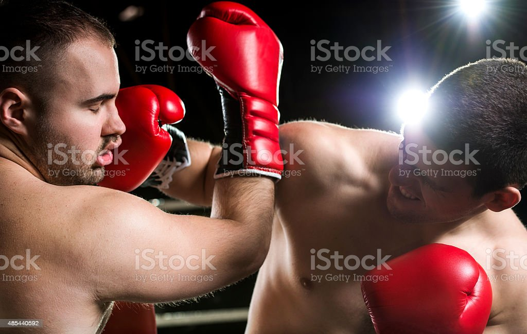 Two boxers during a match. stock photo