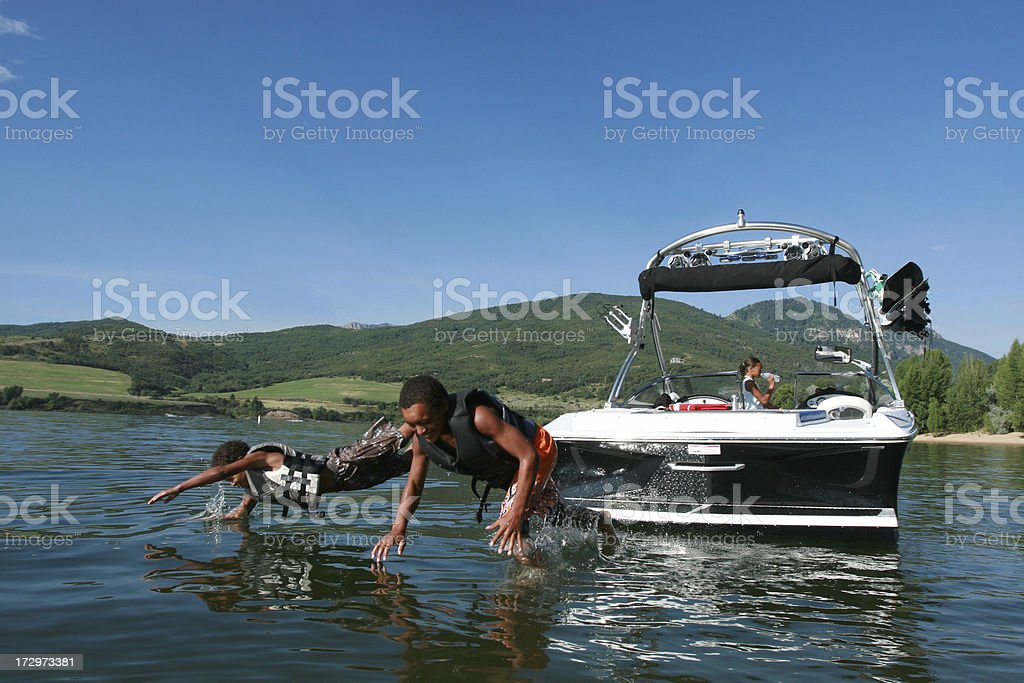 Two boy jumping from the boat royalty-free stock photo