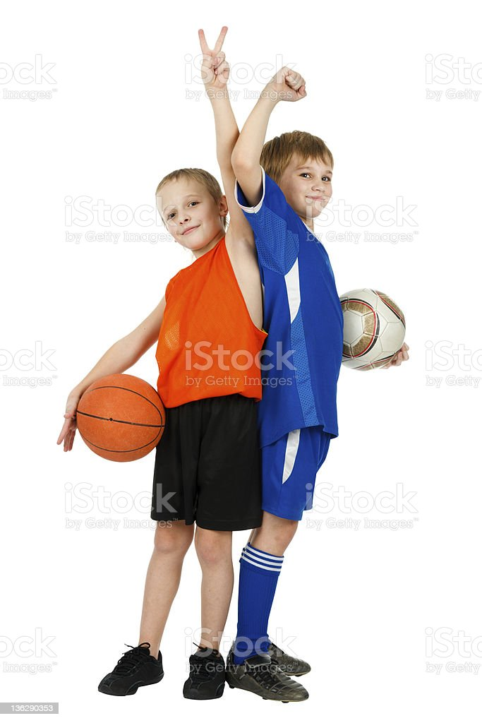 Two boys - a basketball player and footballer with balls royalty-free stock photo