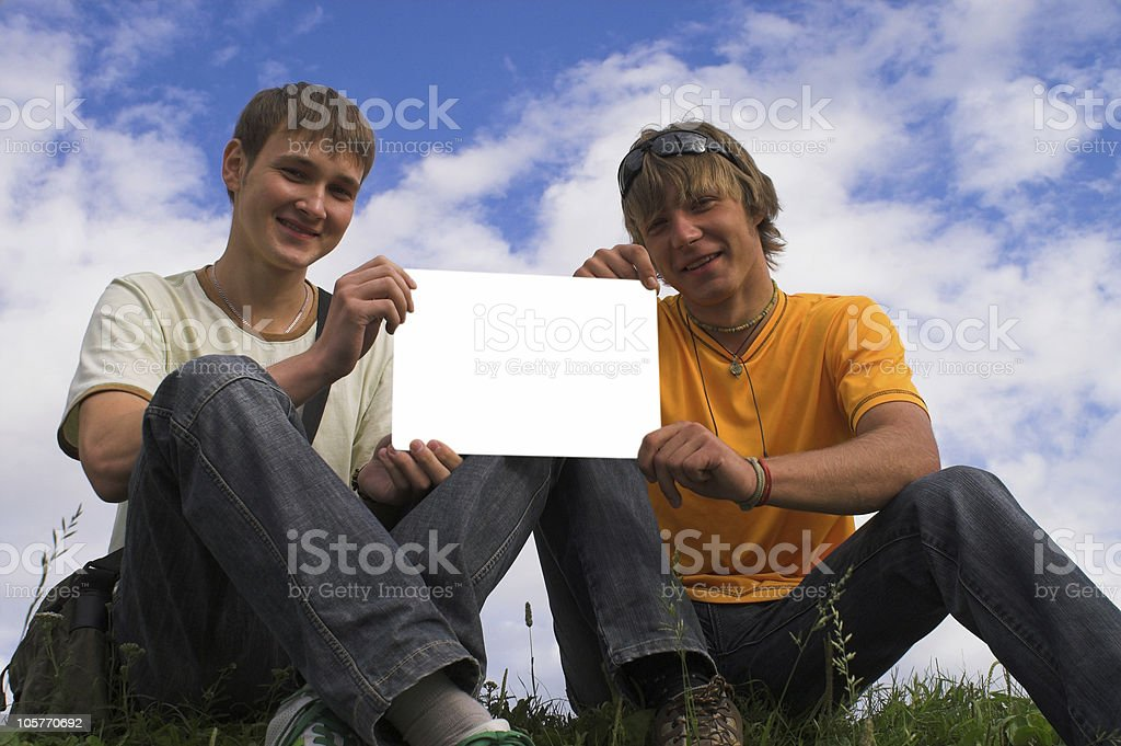 Two boys and clear paper stock photo