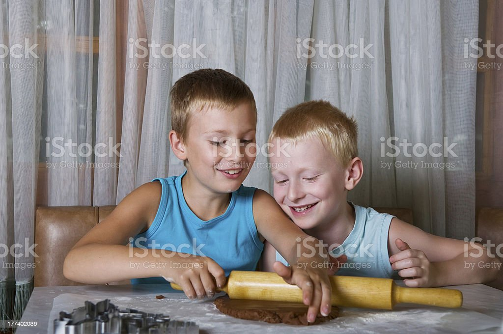 two boys baking cookies royalty-free stock photo