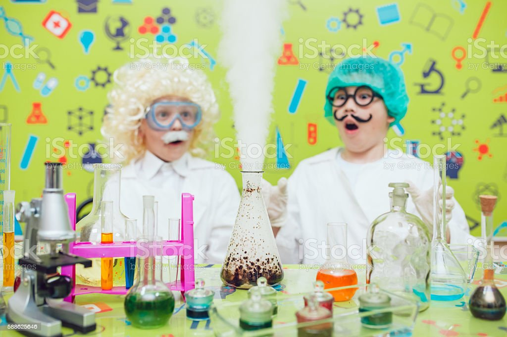 Two boys doing chemical experiments in the laboratory stock photo