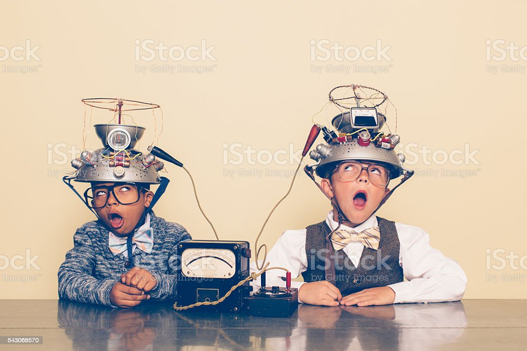 Two Boys Dressed as Nerds Experimenting with Mind Reading Helmets stock photo
