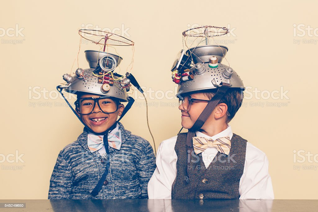 Two Boys Dressed as Nerds Smiling with Mind Reading Helmets stock photo