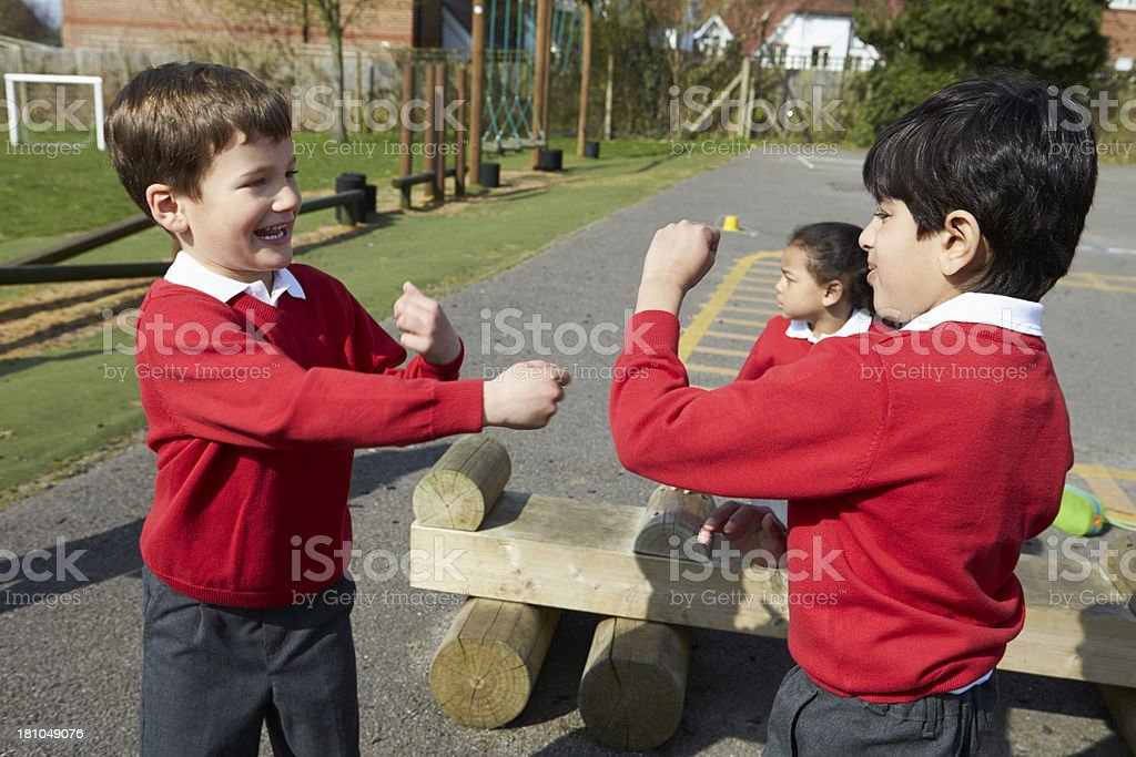 Two Boys Fighting In School Playground royalty-free stock photo