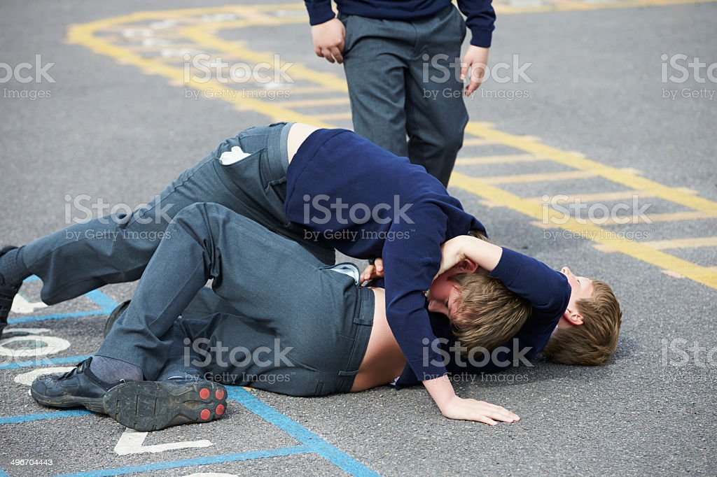 Two Boys Fighting In School Playground stock photo