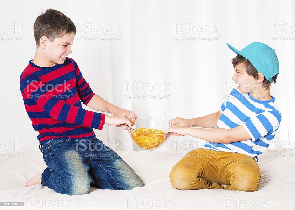 two boys fighting stock photo