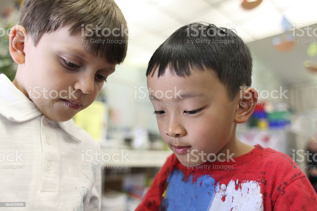 Two boys in classroom stock photo