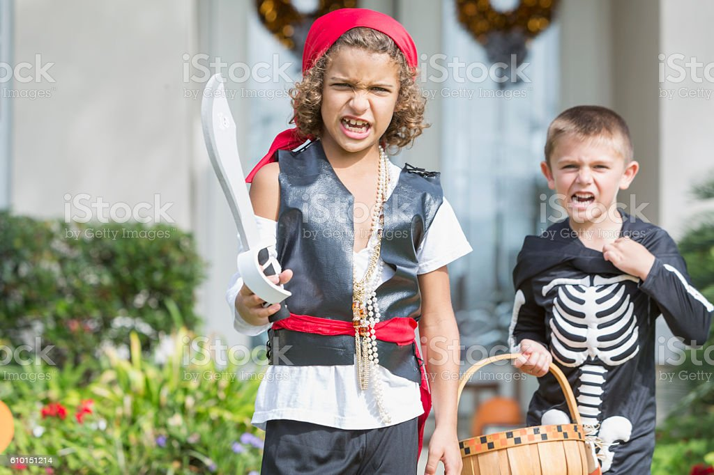 Two boys in halloween costumes stock photo