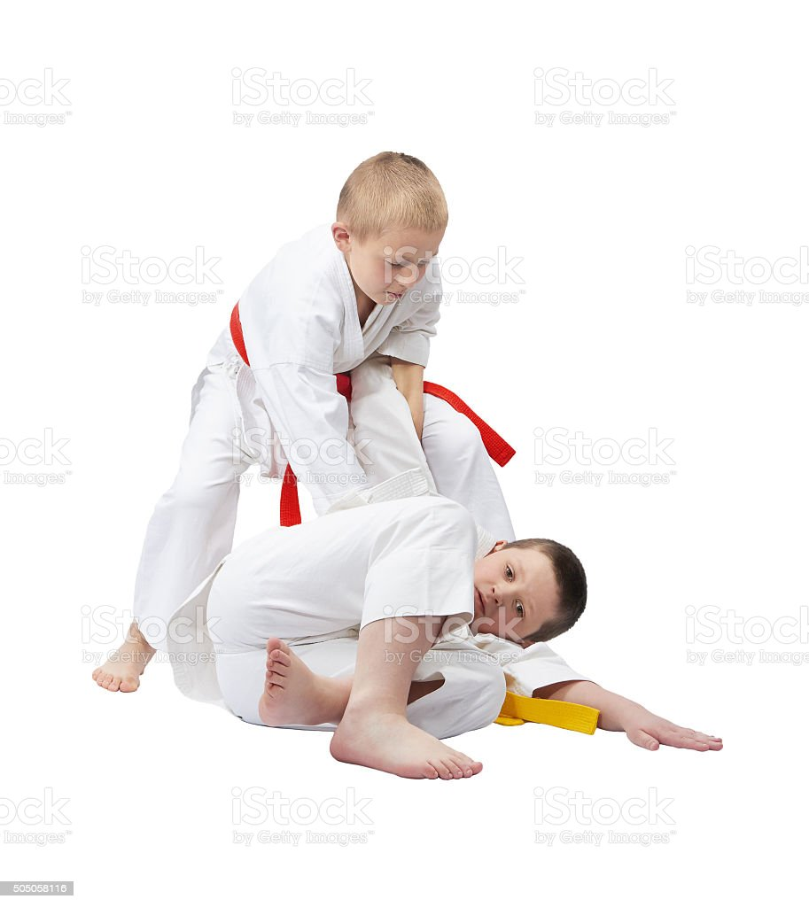 Two boys in judogi are training throws stock photo