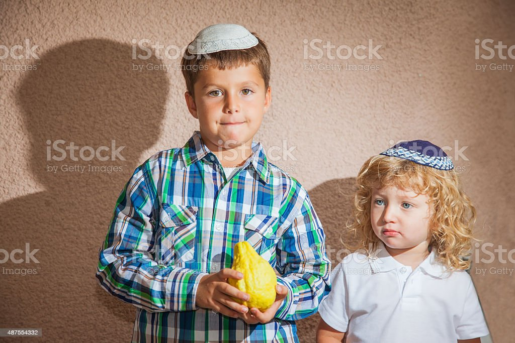 Two boys in yarmulkes stock photo